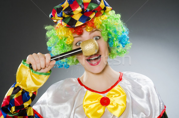 Stock photo: Clown with mic in funny concept