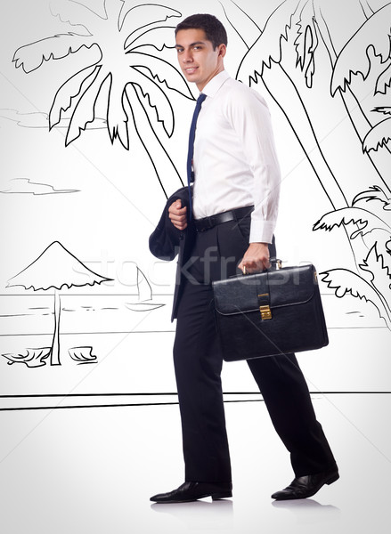 Stock photo: Young businessman dreaming of beach vacation