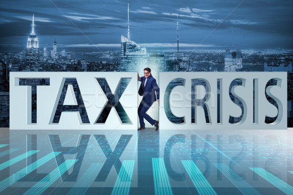 The businessman in tax and crisis concept Stock photo © Elnur