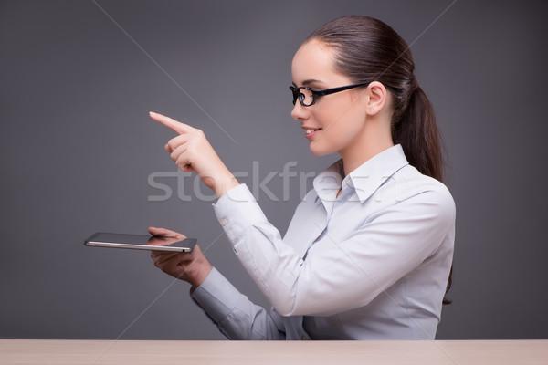 Businesswoman working on tablet computer Stock photo © Elnur