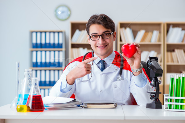 Superhero doctor working in the hospital lab Stock photo © Elnur