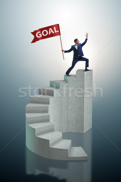 Businessman achieving his business goal objective Stock photo © Elnur