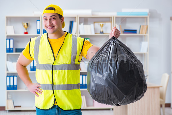 Man cleaning the office and holding garbage bag Stock photo © Elnur