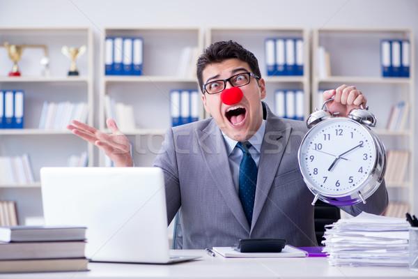 Clown businessman with alarm clock missing dieadline Stock photo © Elnur