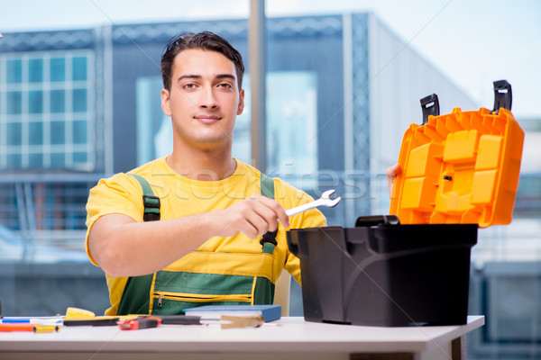 Construction worker sitting at the desk Stock photo © Elnur