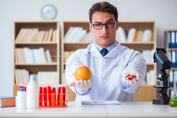 The doctor offering the choice between healthy and vitamins Stock photo © Elnur