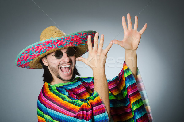 Man in a vivid mexican poncho gray background isolated Stock photo © Elnur