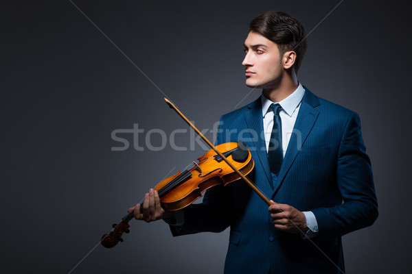 The young man playing violin in dark room Stock photo © Elnur