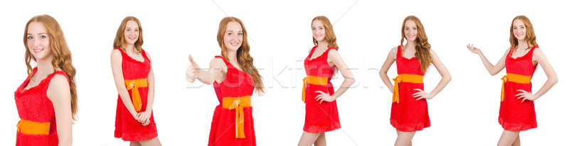The young beautiful girl in red dress thunms up isolated on white Stock photo © Elnur