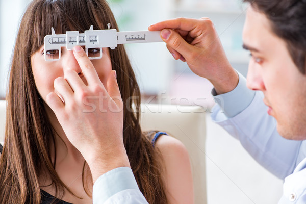 Ophthalmologist is checking up patient in eye doctor hospital Stock photo © Elnur