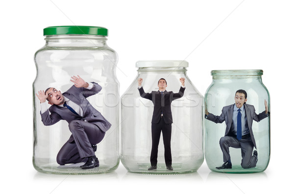 Young businessman in glass jar Stock photo © Elnur