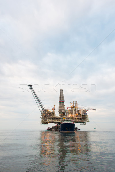 Stock photo: Oil rig being tugged in the sea