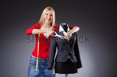 Stock photo: Woman tailor working on clothing