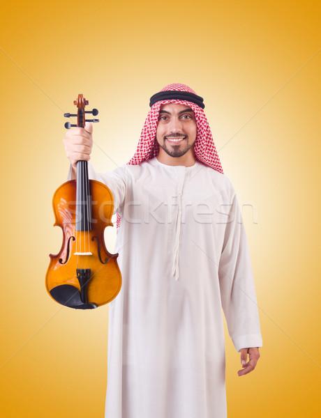 Arab man playing music on white Stock photo © Elnur