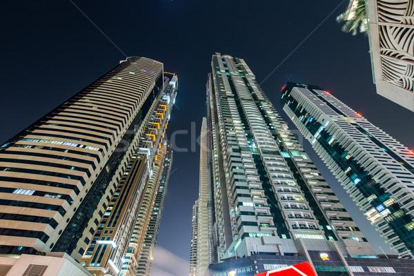 Dubai marina felhőkarcolók éjszaka égbolt víz Stock fotó © Elnur