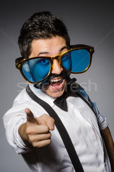 Moço falso bigode grande óculos de sol isolado Foto stock © Elnur