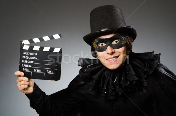Man wearing mask with movie board Stock photo © Elnur
