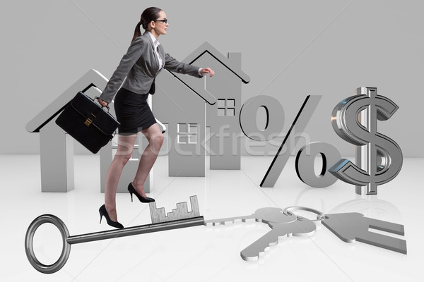 Businesswoman walking climbing stairs in mortgage Stock photo © Elnur