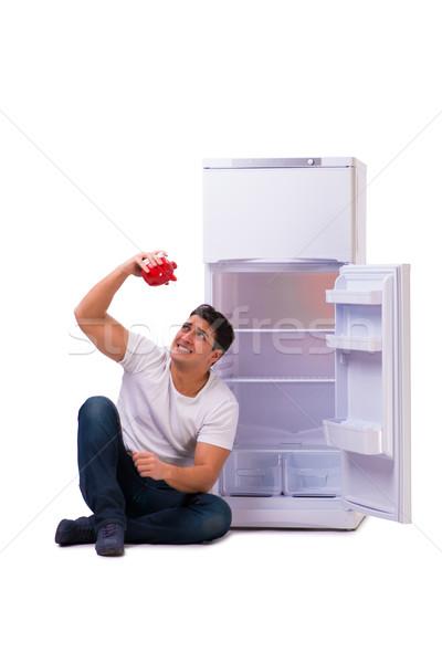 Hongerig man naar geld koelkast voedsel Stockfoto © Elnur
