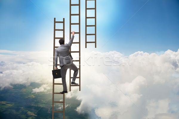 üzletember mászik karrier létra üzlet állás Stock fotó © Elnur