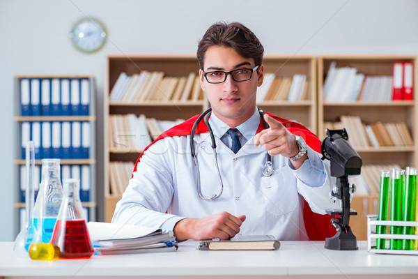Superhero doctor working in the hospital lab Stock photo © Elnur