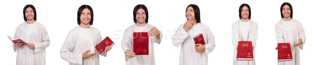 Young priest with bible isolated on white Stock photo © Elnur