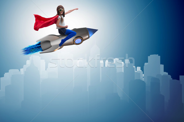 Little girl flying rocket in superhero concept Stock photo © Elnur
