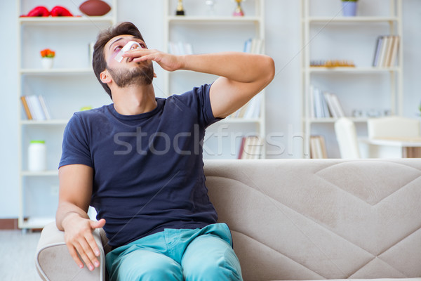 Young man recovering healing at home after plastic surgery nose  Stock photo © Elnur
