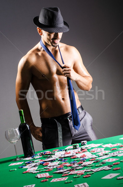 Naked broke businessman in casino Stock photo © Elnur