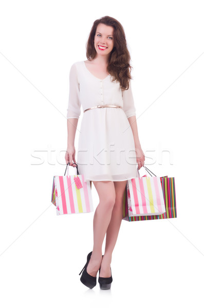 Tall girl after good shopping on white Stock photo © Elnur