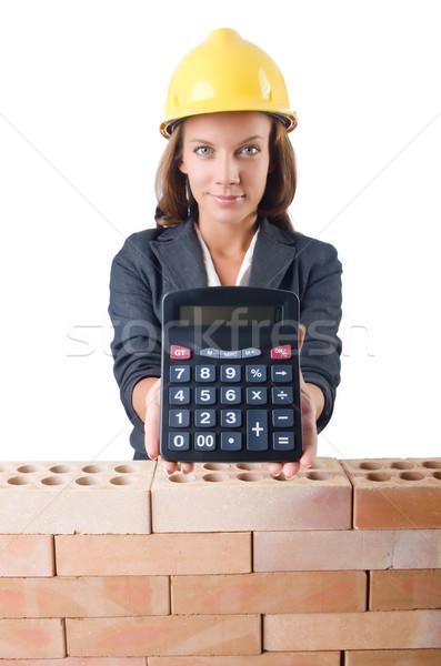 Vrouw bouwvakker calculator witte business muur Stockfoto © Elnur