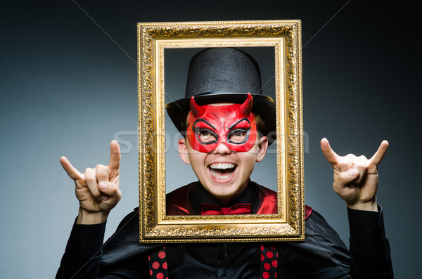 Funny devil with picture frame Stock photo © Elnur