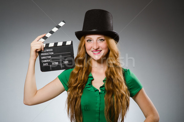 Woman wearing green dress with movie board Stock photo © Elnur