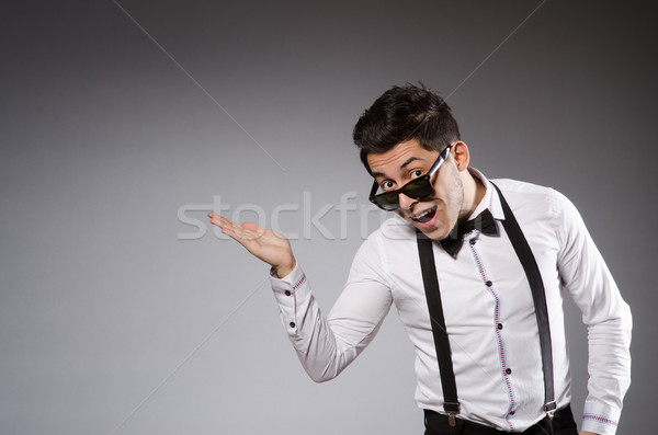 Young stylish man wearing sun glasses isolated on gray Stock photo © Elnur