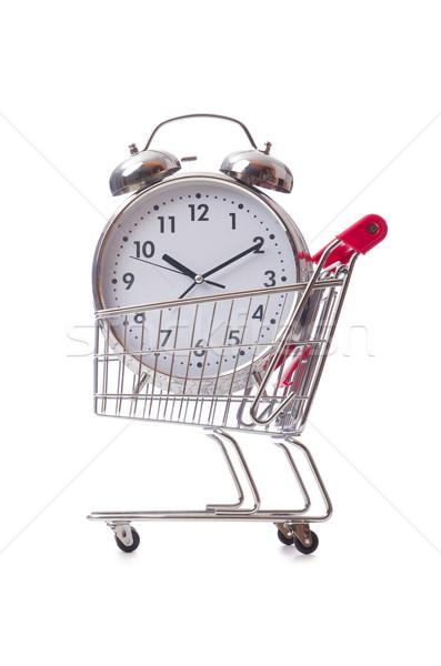 Big alarm clock in shopping cart on white Stock photo © Elnur