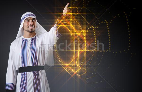Arab férfi kisajtolás virtuális gombok futurisztikus Stock fotó © Elnur
