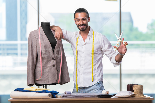 Young tailor working on new clothing design Stock photo © Elnur