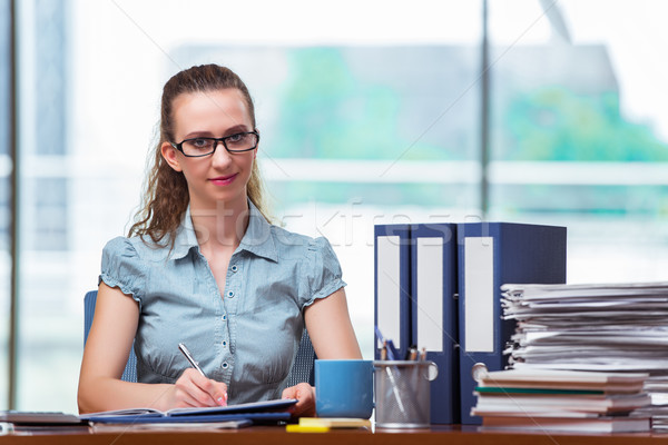 Young businesswoman working in the office Stock photo © Elnur