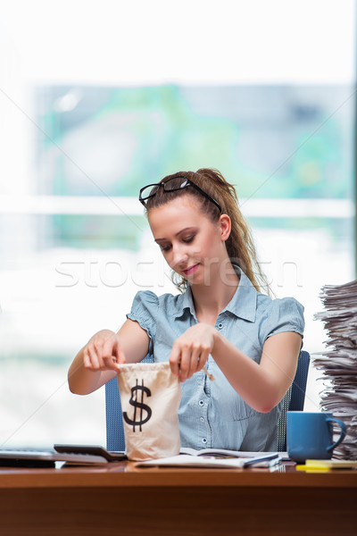 Businesswoman with money sacks in the office Stock photo © Elnur