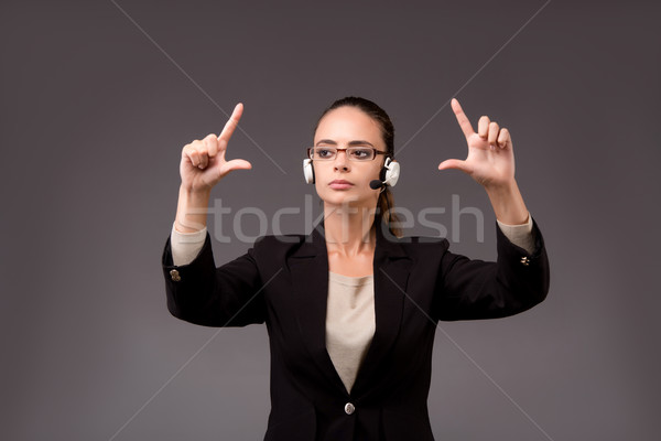 Young woman businesswoman pressing virtual buttons Stock photo © Elnur