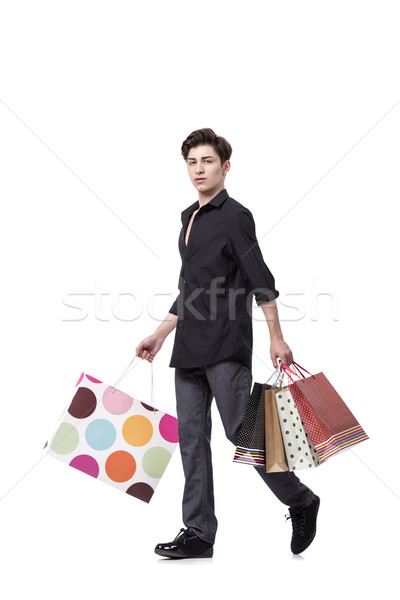 Young man in shopping concept isolated on white Stock photo © Elnur