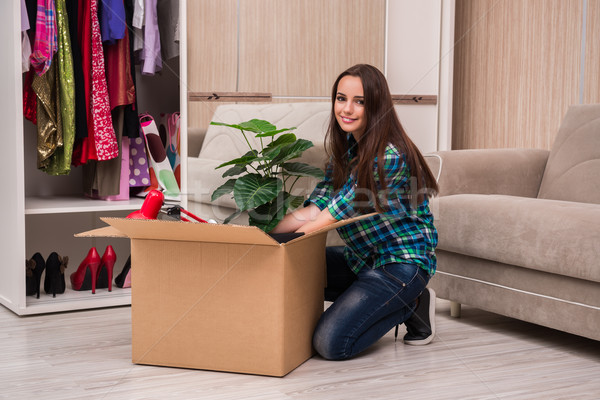 The young woman packing personal belongings Stock photo © Elnur