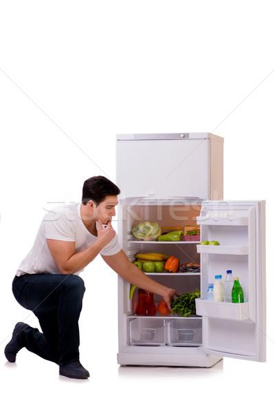 Man koelkast vol voedsel huis gelukkig Stockfoto © Elnur