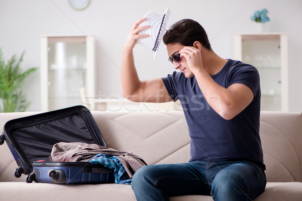 Man going on vacation packing his suitcase Stock photo © Elnur