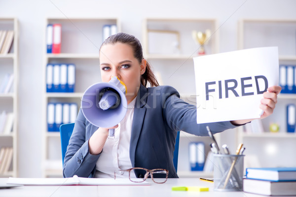 Angry businesswoman issuing termination notice Stock photo © Elnur