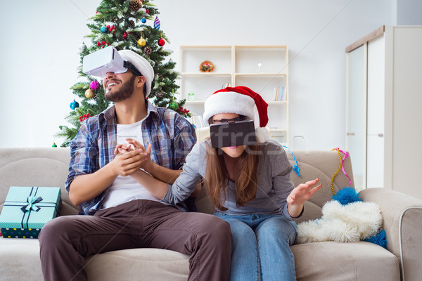The happy family using virtual reality vr glasses during christmas Stock photo © Elnur