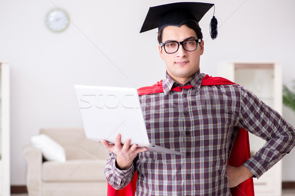 Super hero student wearing mortarboard and holding a laptop Stock photo © Elnur