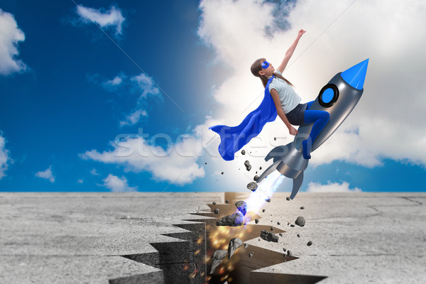 Superhero kid flying on rocket Stock photo © Elnur