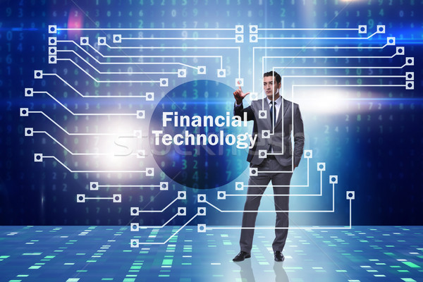 Businessman pressing buttons in fintech concept Stock photo © Elnur