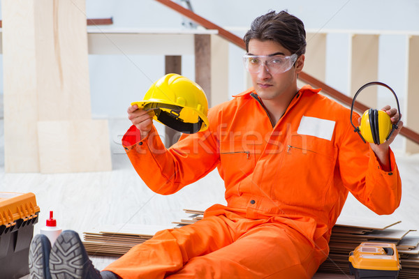Stock photo: Worker showing the importnace of wearing noise cancelling headph